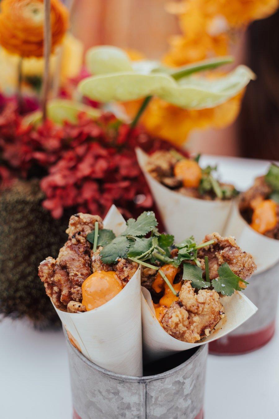 mexican wedding menu with cones of popcorn chicken