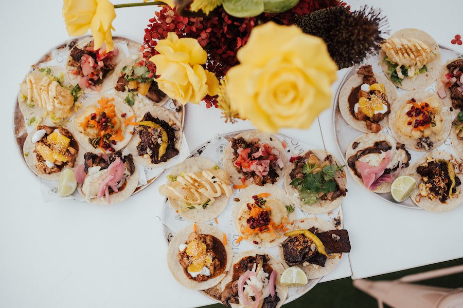 mexican wedding menu with plates of tacos