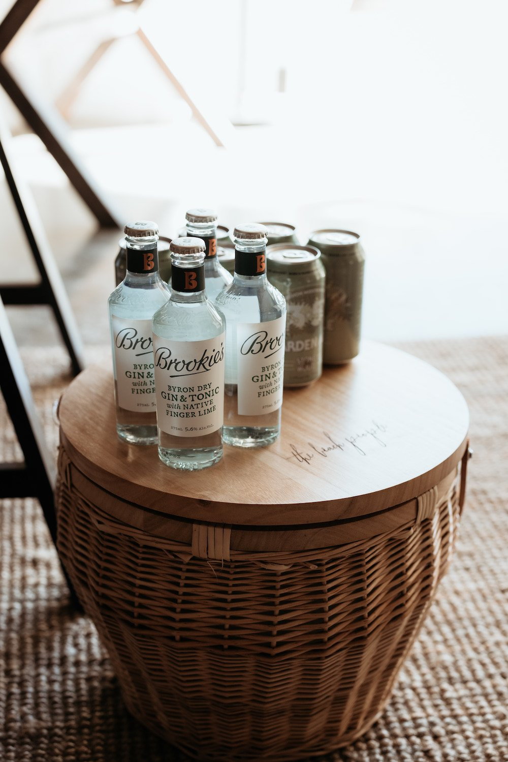 The Beach People picnic basket with brookies gin bottles, friends of the acre