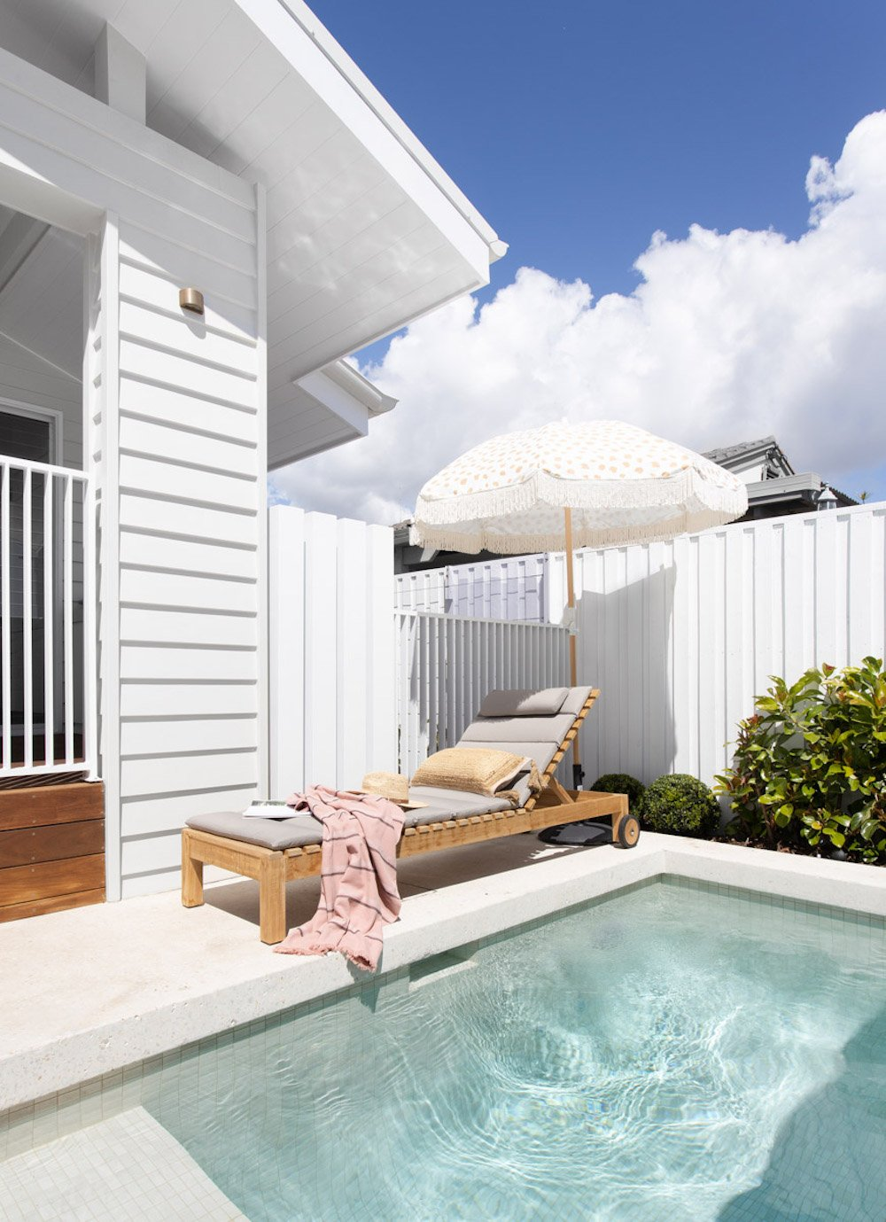 Gold Coast wedding accommodation pool and deck chair in sun